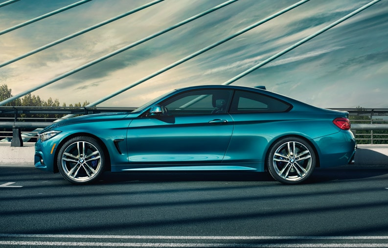 Profile shot of the 2019 BMW 4 Series Coupe parked on a suspension bridge
