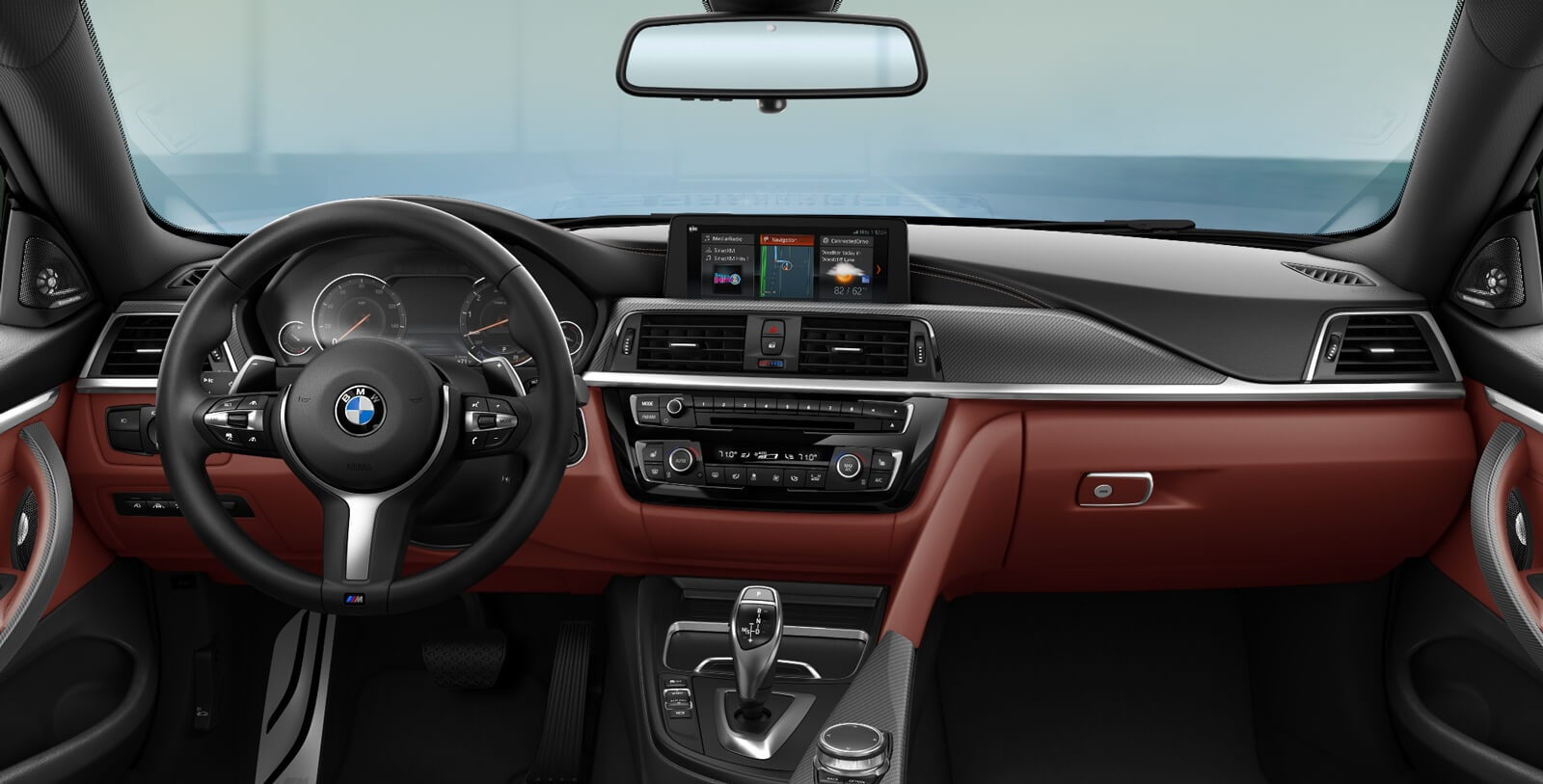 Interior shot of the 2019 BMW 4 Series Coupe showing steering wheel, instrument cluster, iDrive screen, and driving controls