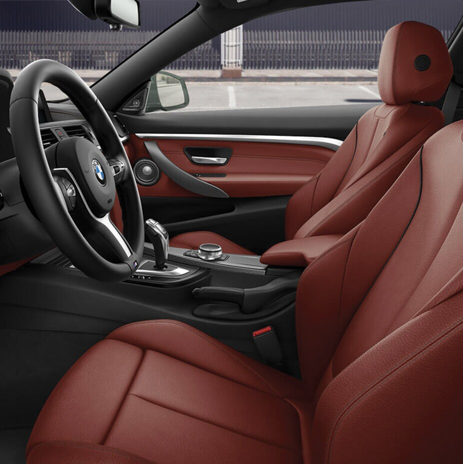 Driver's seat of the 2019 BMW 4 Series Coupe in coral red dakota leather