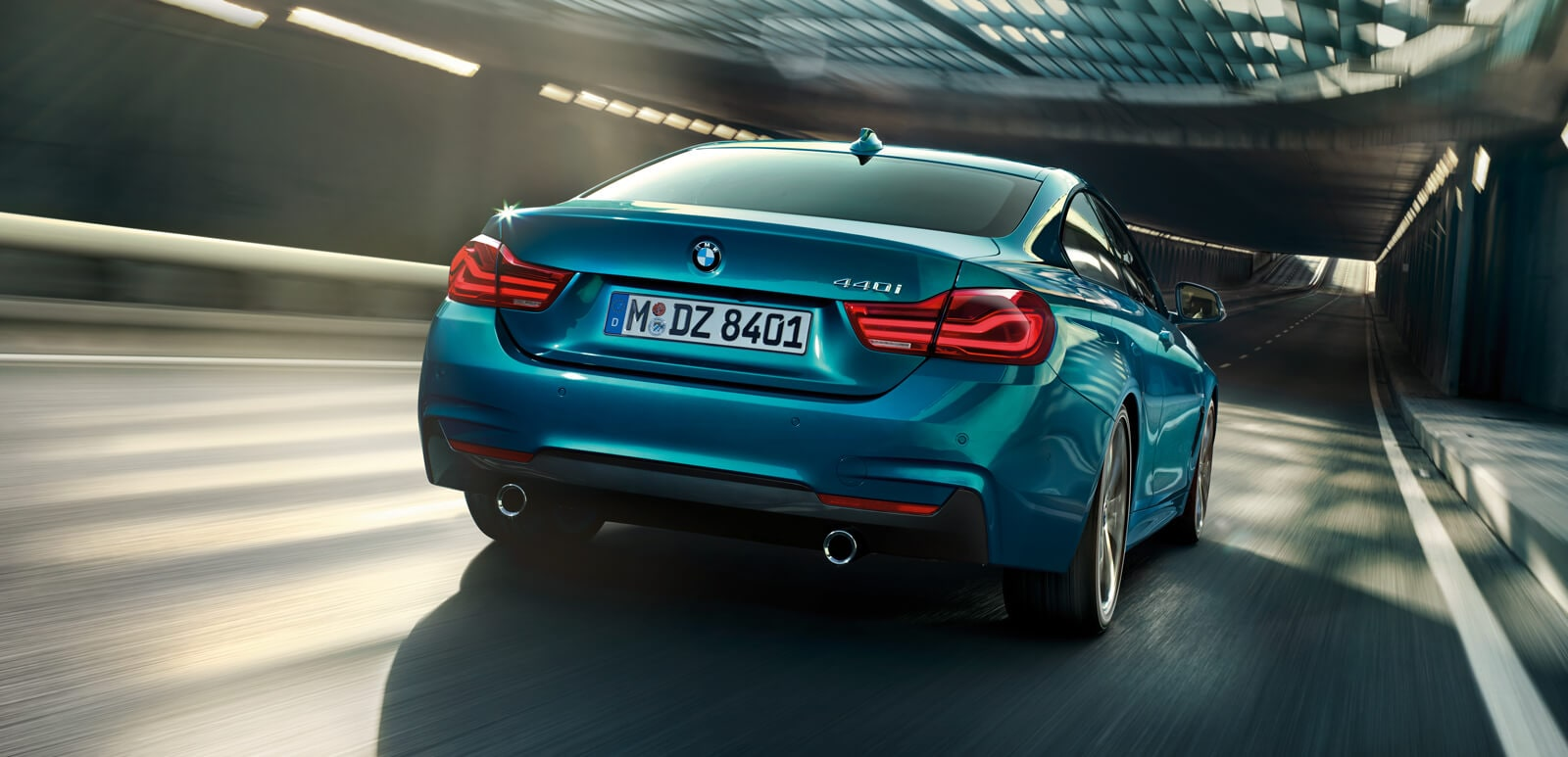 Rear shot of a 2019 BMW 4 Series Coupe entering a tunnel