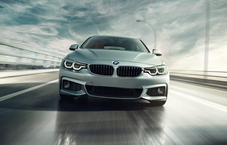 Front shot of the 2019 BMW 4 Series Gran Coupe driving on a highway