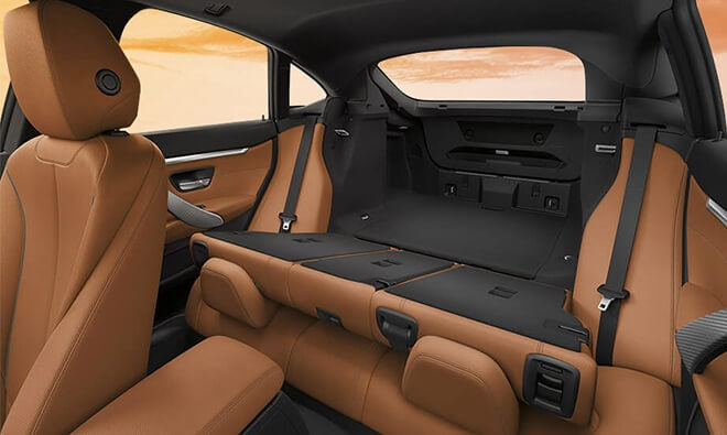 Interior shot of split fold down rear seats and cargo space of the 2019 BMW 4 Series Gran Coupe