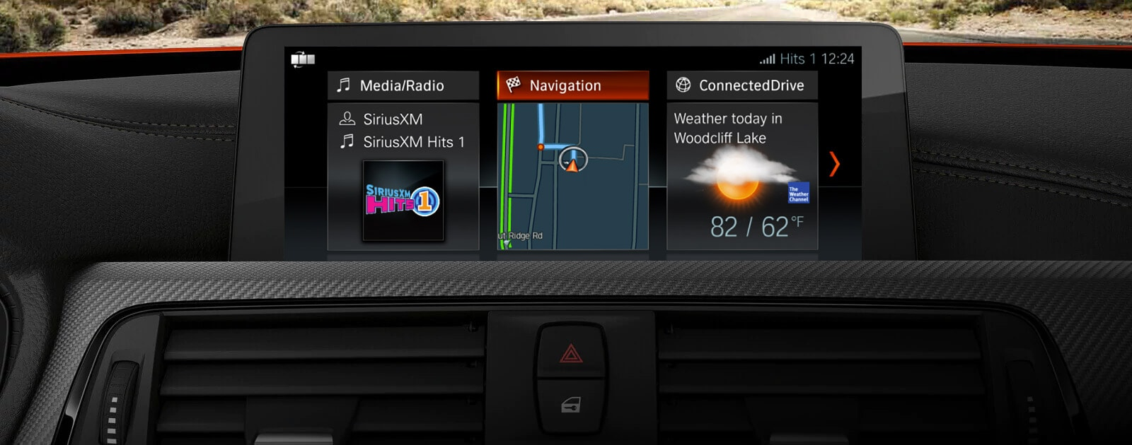 Closeup of the iDrive screen in the 2019 BMW 4 Series Gran Coupe, showing BMW Navigation, media player, and weather forecast