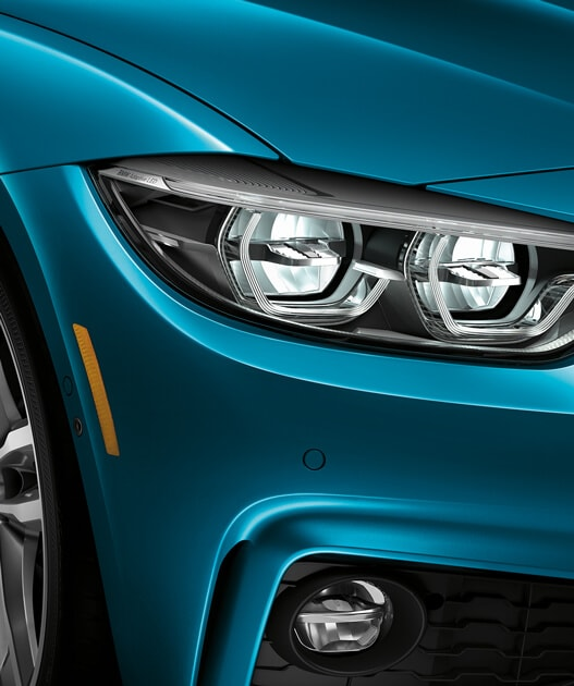 Closeup of the 2019 4 Series Coupe Optional Icon Adaptive Full LED Lights and standard LED fog lights