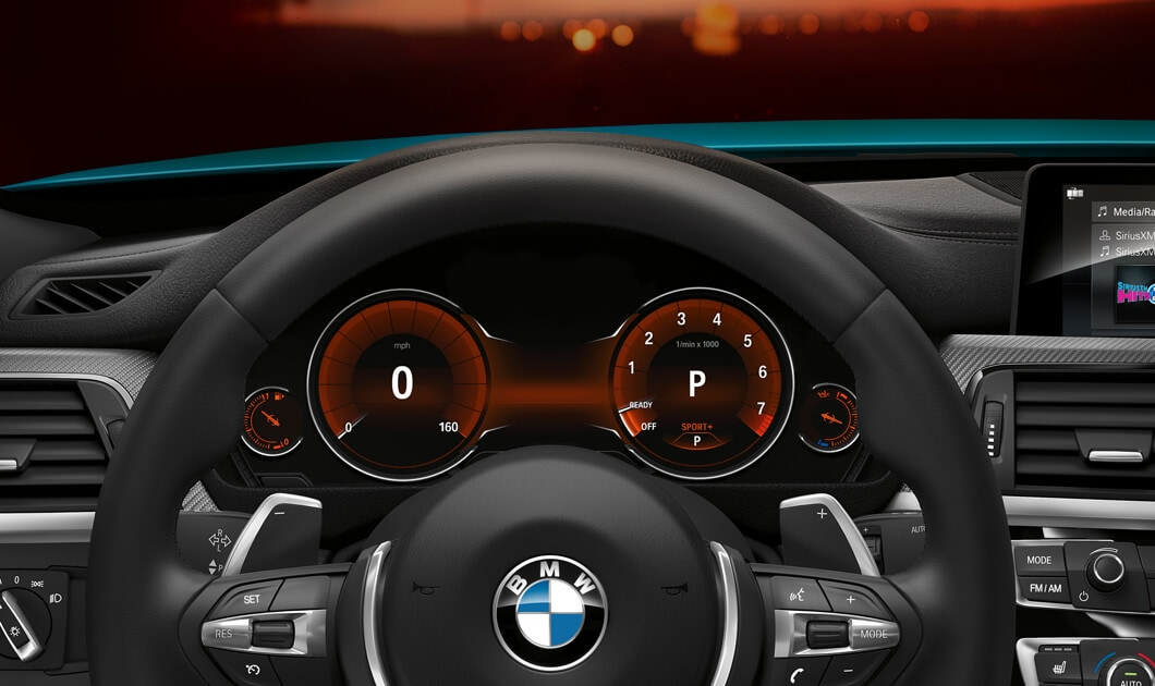 Driver's eye view of the 2019 4 Series Coupe with steering wheel and instrument cluster