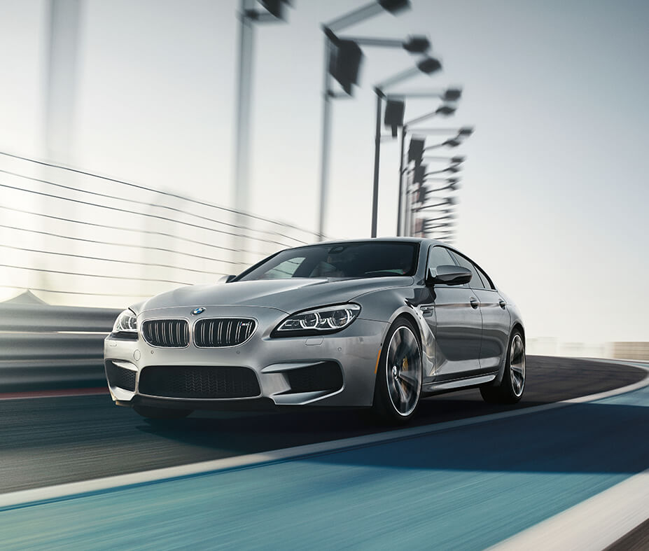 A 2019 BMW M6 Gran Coupe racing on the track