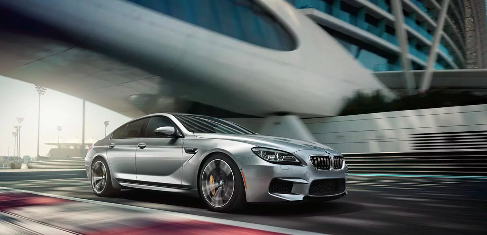 Close shot of the 2019 BMW M6 Gran Coupe accelerating on a racetrack